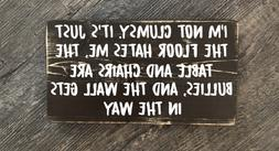 I'm not clumsy it' just the floor hates me Wood hanging sign